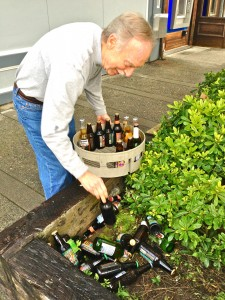 Chris Smith retrieves 34 bottles of beer from the planter out back.