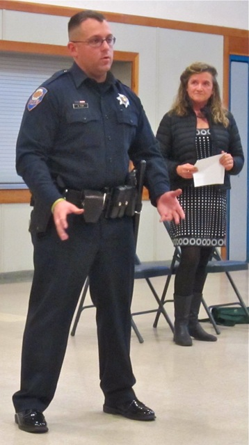 Officer Anthony Fox and City Councilmember Susan Ornelas.