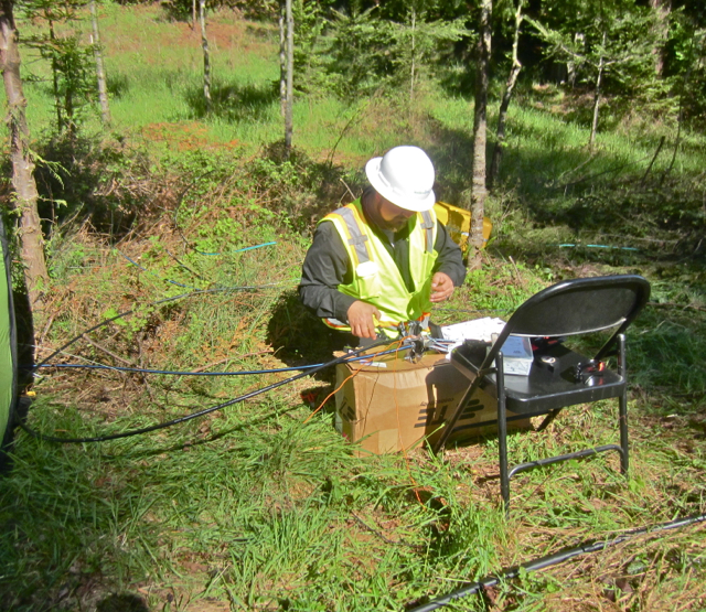 A Suddenlink field technician mends the slashed cable on Old Arcata Road. KLH | Eye