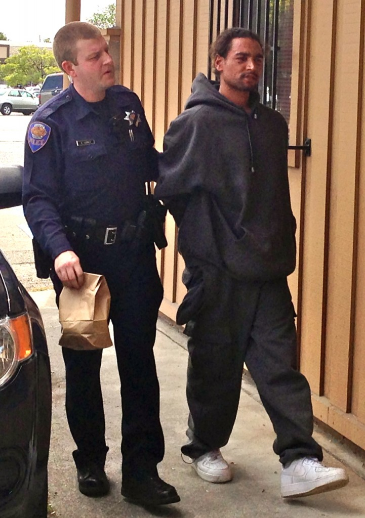Homicide suspect Bodhi Tree is led into APD. KLH | Eye