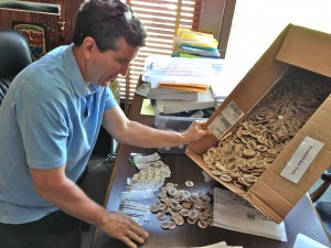 Bill Chino begins the unenviable task of counting beer chips and ticket stubs in his Jacoby's Storehouse office.