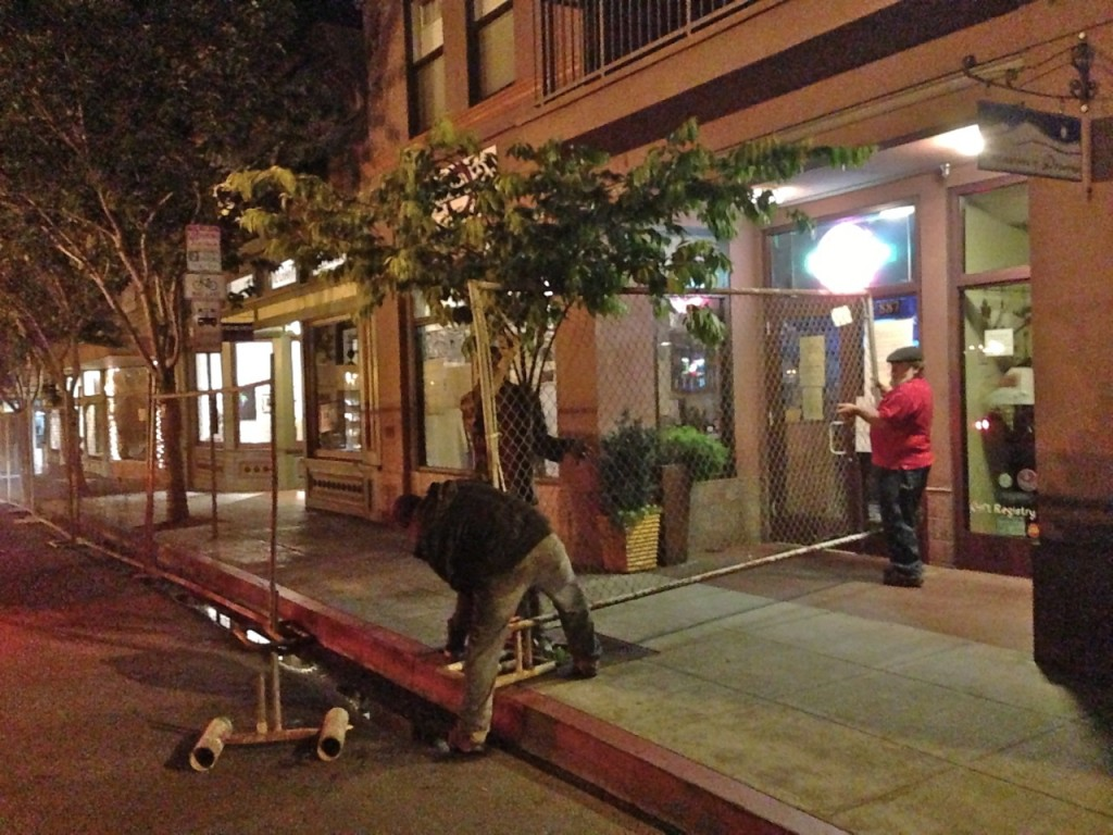 Workers from the Craftsman's Mall install the OysterFence in the early morning hours of June 15. KLH | Eye