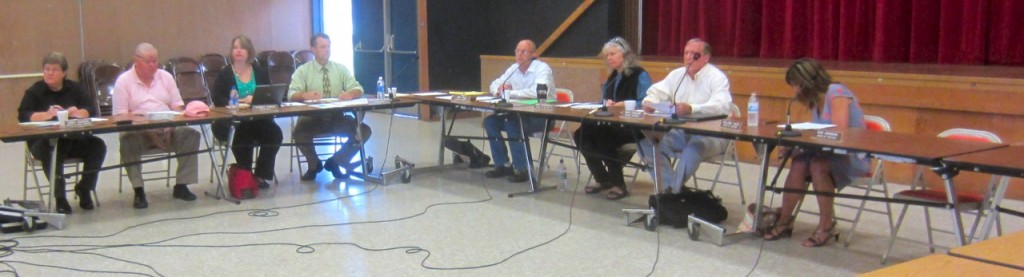 NHUHSD staff and four-fifths of its board – not including the subject of the meeting, Dan Johnson, who would have occupied the seat on the right – in the AHS Multipurpose Room. KLH Eye