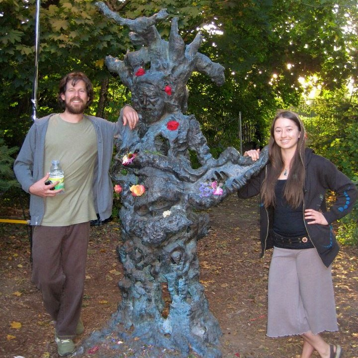 Nicholas Jackson and Sarah Keeble with a statue of Jerry Garcia at McMenamin's Edgefield Hotel in Oregon last October. The Sunny Brae residents are enrolled in PG&E's CARE program, which offers a roughly 50 percent discount for low-income ratepayers' electricity bill. Facebook photo