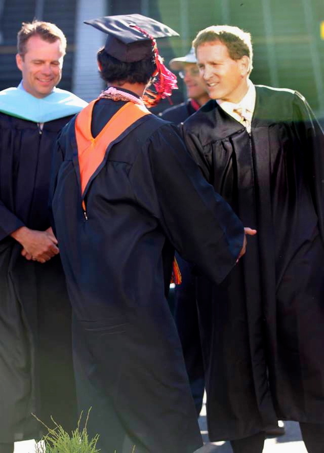 NHUHSD Superintendent Chris Hartley, an Arcata High School Class of 2013 graduate and Trustee Dan Johnson at the June 13 commencement. Submitted photo