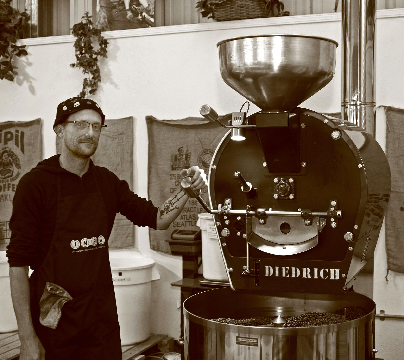 Kinetic Koffee roaster Kelly Brannon at the helm of Diedre, the Diedrich roaster. Photo by Matt Filar.
