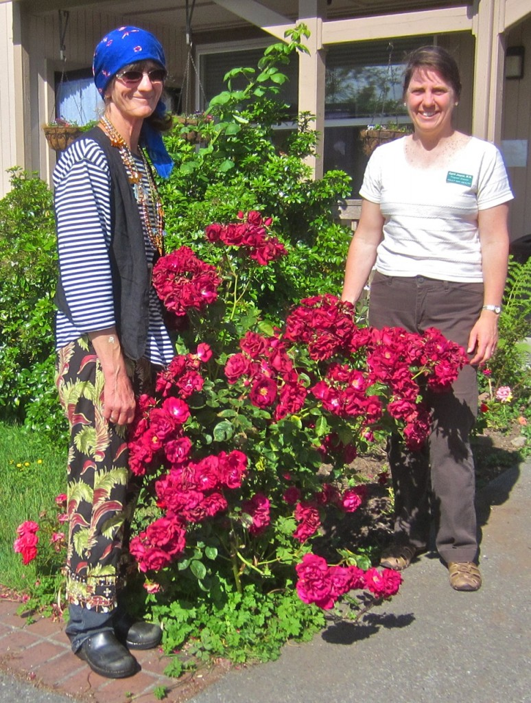 Virginia Moyer (it was Dress Like A Pirate Day) and April Joyce with one of the flower bushes that wasn't stolen.  KLH | Eye